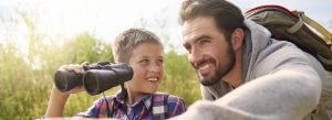 Header-father-and-son-with-binoculars